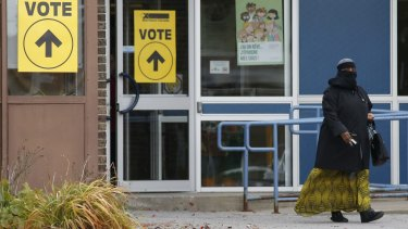 A woman wearing a niqab leaves the Ecole Marius-Barbeau polling station in Ottawa, after casting her vote in the Canadian federal election on Monday.