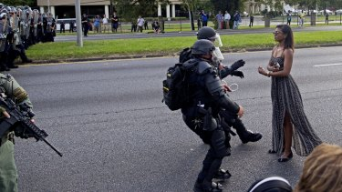 Making a stand: Police officers in riot gear face Leshia Evans during a protest in Baton Rouge.