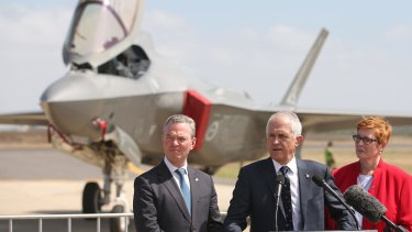 Defence Industry Minister Christopher Pyne, Prime Minister Malcolm Turnbull, and Defence Minister Marise Payne speak to the media after inspecting a Joint Strike Fighter at Avalon Airshow in March.