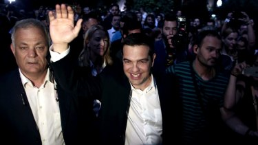 Greek Prime Minister Alexis Tsipras waves as he arrives at the Greek state broadcaster ERT in Athens on Thursday.