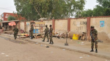 Soldiers at the scene of an explosion at a market in Kano, Nigeria, on Wednesday.