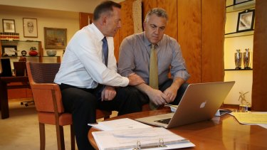 On Tuesday, Abbott and Hockey took part in a contrived photo opportunity pretending to go over drafts.