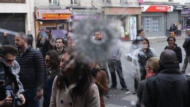 Bullet holes near La Belle Equipe cafe.