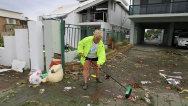 Beverley Bultitude starts the clean up outside her Kurnell home.