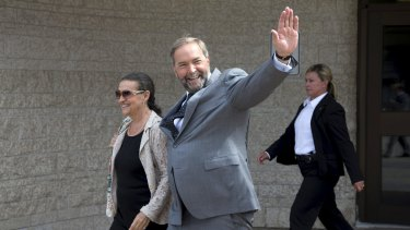 New Democratic Party leader Thomas Mulcair waves in Gatineau, Quebec on Sunday.