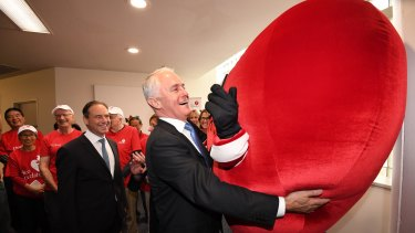Malcolm Turnbull gets up close to National Heart Foundation mascot Have a Heart at Sydney's St Vincent's Hospital.