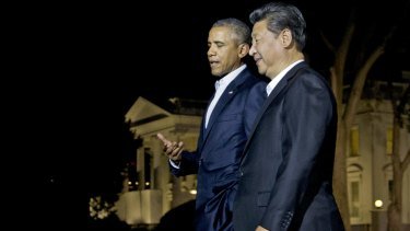 US President Barack Obama and Chinese President Xi Jinping walk on the North Lawn of the White House in Washington on Thursday evening.