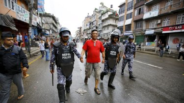 Nepalese police detain a protester during a general strike on Sunday.
