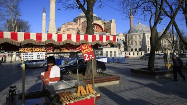 Bad for tourism: A vendor waits for customers at the near-empty plaza in front of the Byzantine-era Hagia Sophia, in the historic Sultanahmet district of Istanbul, following the explosion.