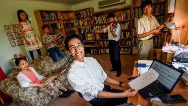 Stephen Zhang at home with his family.