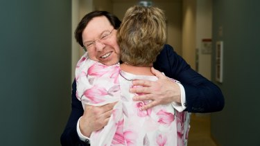 Professor John Rasko gets a hug from Eunice Lee, after her son, Mark, successfully completed a gene therapy trial for haemophilia at the Charles Perkins Centre at RPA in Sydney.