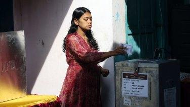 An Indonesian woman casts her ballot.