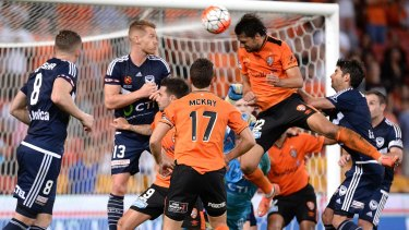 Heading home: Brisbane's Thomas Broich scores the goal that sent defending champions Melbourne Victory tumbling out of the finals race.