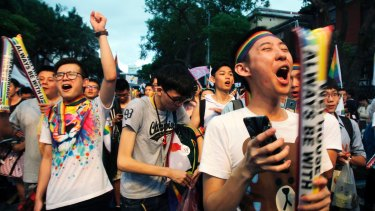 Same-sex marriage supporters cheer outside the Legislative Yuan in Taipei after the Constitutional Court ruled in favour of same-sex marriage.