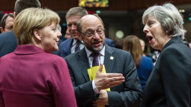 German Chancellor Angela Merkel, left, speaks with British Prime Minister Theresa May, right, and European Parliament President Martin Schulz, centre, in Brussels on Thursday.
