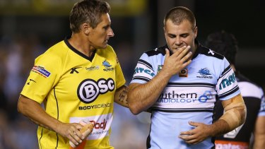 Heavy knock: Wade Graham leaves the field after a clash during the round four NRL match between the Cronulla Sharks and the Melbourne Storm at Southern Cross Group Stadium.