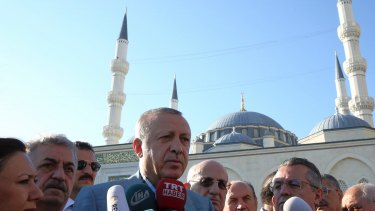 Recep Tayyip Erdogan speaks to the media outside a mosque after the Eid al-Fitr prayers in Istanbul, early on Sunday.