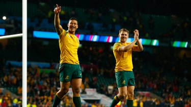 Hard-earned win: Israel Folau and Drew Mitchell celebrate their victory over Wales at Twickenham.