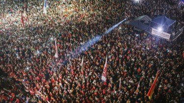 Anti-impeachment protesters attend a rally in Rio while former president Lula speaks.