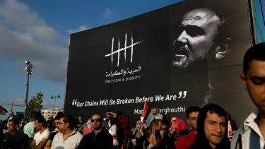 Protesters gather under a banner of jailed Palestinian leader Marwan Barghouti in the West Bank city of Ramallah earlier this month.