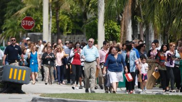 People evacuated due to a bomb threat return to the David Posnack Jewish Community Centre in Davie, Florida, in February.