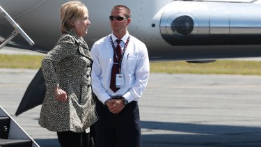Democratic presidential candidate Hillary Clinton steps from her campaign plane as she arrives in Nantucket, Massachusetts, en route to a fundraiser.