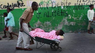 A patient with cholera symptoms taken to to the Doctors Without Borders (MSF) cholera treatment centre in the slum neighbourhood of Cite Soleil  in Port-au-Prince in 2010.