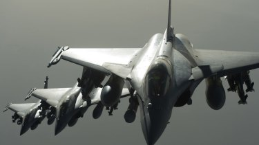 French army Rafale fighter jets fly towards Syria as part of France's support of the US-led coalition against Islamic State group. France is the world's fourth-largest weapons supplier.