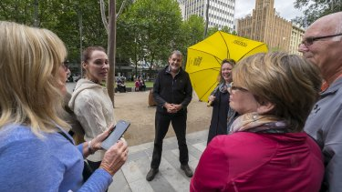 Melbourne Walking Festival organiser Stephen Ingrouille (centre) with walkers in Melbourne CBD.