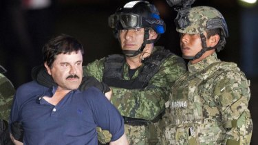 El Chapo is made to face the press as he is escorted to a helicopter following his recapture in January.