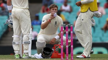England's Joe Root has a drink of water at the SCG on Monday.