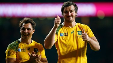 Delighted duo: Kane Douglas (right) and Nick Phipps celebrate after the 2015 Rugby World Cup Pool A match between Australia and Wales at Twickenham Stadium.