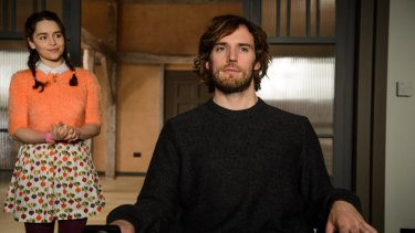 Emilia Clarke as Lou Clark and Sam Claflin as Will Traynor in <i>Me Before You</i>.