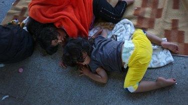 Refugee children sleep on the outdoor floor of the Keleti railway station in Budapest, Hungary.