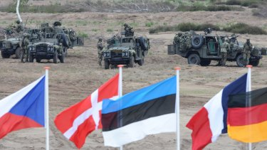 Soldiers take positions with their army vehicles during the NATO Noble Jump exercise on a training range near Swietoszow Zagan, Poland, in 2015. Poland said on Wednesday it welcomes a US plan to quadruple military spending in Europe.