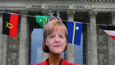 A woman wears an Angela Merkel mask during an anti-Nazi demonstration in front of the Reichstag building in Berlin.