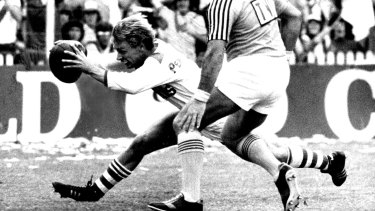 22 September 1979 St. George fullback Brian Johnson goes in for a controversial try in yesterday's Grand Final. Referee Greg Hartley is on the spot. Fairfax Media