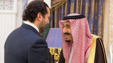 Saudi King Salman, right, shakes hands with Lebanese Prime Minister Saad Hariri in Riyadh after Hariri's 'resignation'.
