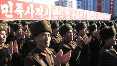 "North Korean military personnel applaud at a rally in Pyongyang on Friday after North Korea said it had conducted a ""successful"" hydrogen bomb test."