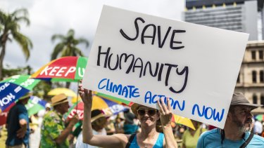 People rally for climate action in Brisbane last month. Australia has ranked poorly on its climate performance among major emitters, according to a new score card.