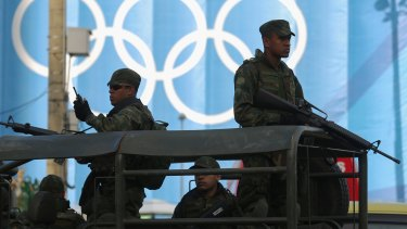 Under scrutiny: Brazilian soldiers keep watch in front of the beach volleyball venue.