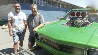 The morning after: Andy Lopez, Summernats co-owner, left, says good bye to Canberra's Brad Sullivan who brought his supercharged outlaw LX Torana SS to the event for the first time.