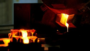 Mixed gold and silver are poured into ingot moulds at the furnace facility of Akara Mining's Chatree gold mine near Phichit village, 280-kilometres north of Bangkok.