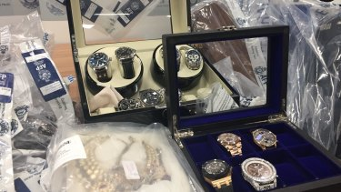 Police have seized hundreds of items, including $500,000 in watches, but believe half of the syndicate's $165 million will never be recovered.