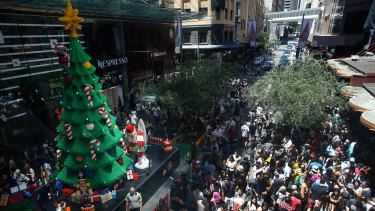 Bargain hunters: Hundreds of shoppers descend on Pitt Street shopping mall for the Boxing Day sales.