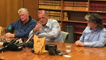 George ''Joe'' Booth, his son Greg Booth, and Adrian Richardson at a press conference in Hobart on Wednesday.
