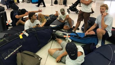 A group of surfers from Sydney wait for updates on their cancelled flight to Sumatra via Denpasar on November 27, 2017.