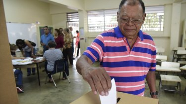 Puerto Rico resident Hector Alvarez casts his ballot during the US territory's Democratic primary election.