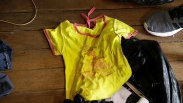 """Children's clothing found on the floor of a cybersex """"den"""" in the Philippines in April."""