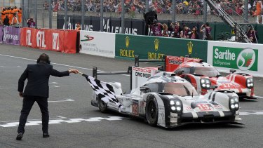Germany's Nico Hulkenberg in his Porsche 919 crosses the line to win the 83rd Le Mans 24 Hours endurance race.